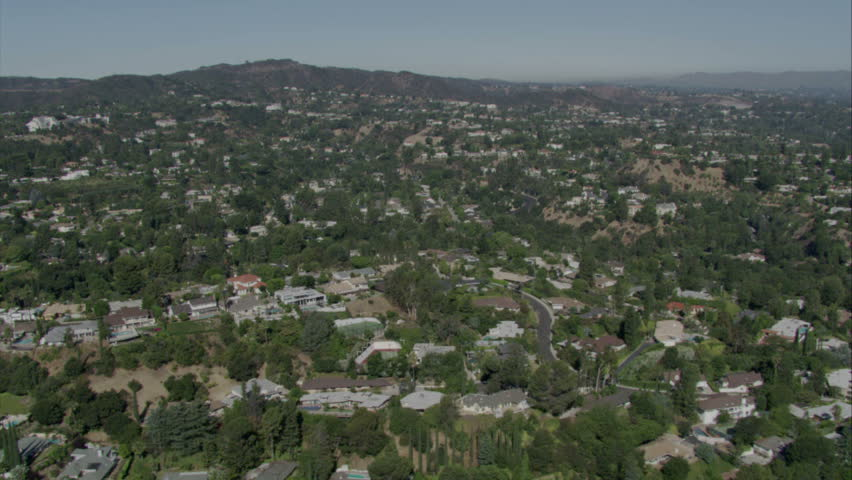 Fly over of homes in a residential area in the foothills of Southern California