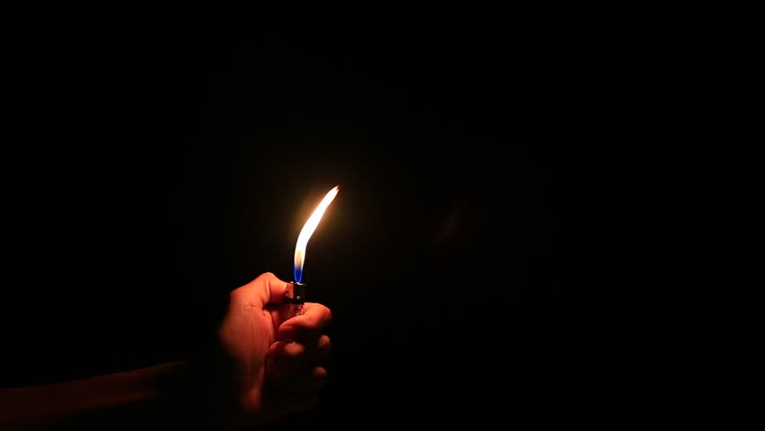 the big flame glowing on the lighter  on black background - HD stock footage clip & Man Lighting A Match. Man Hand Holding And Lighting A Match. Stock ... azcodes.com