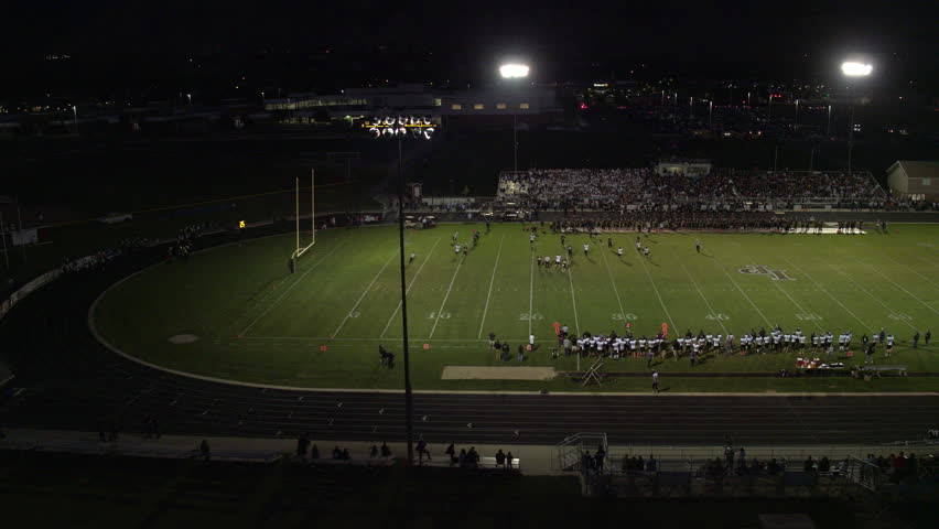 Aerial pan of High School football night game, circa September 2016.