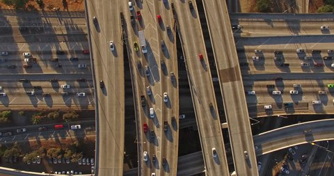 4K UHD vertical aerial top down view of heavy traffic on 10 freeway in Downtown, Los Angeles, California.