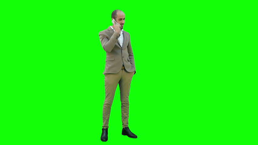 Arabian business man talking on the phone on a Green Screen, Chroma Key.