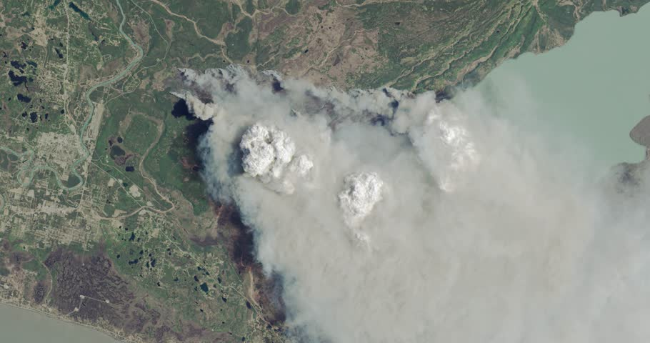 Aerial zoom out over the 2014 Funny River fire, Kenai Peninsula, Alaska. Elements of this image furnished by NASA.