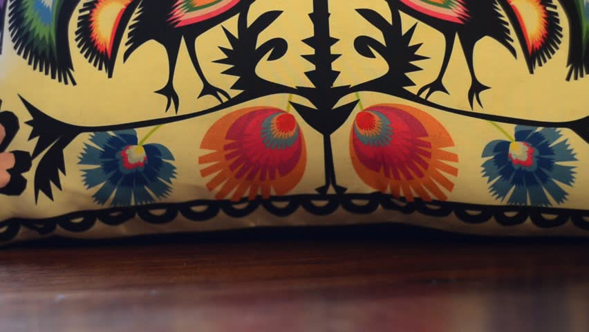Colored roosters on the pillow | Shutterstock HD Video #22883125