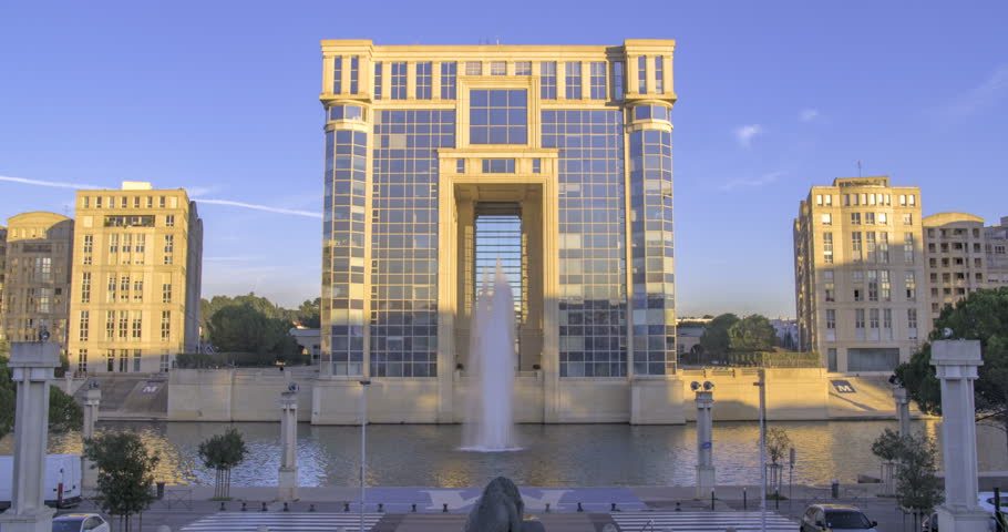 MONTPELLIER, FRANCE - DECEMBER 3, 2016 - Time lapse sliding view of a contemporary iconic building and a fountain in Montpellier, France