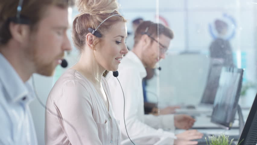 4K Friendly customer service operators taking calls in busy call center Dec 2016-UK | Shutterstock HD Video #22933855