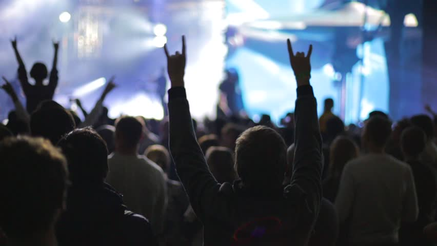 People partying at live music concert, slow-motion