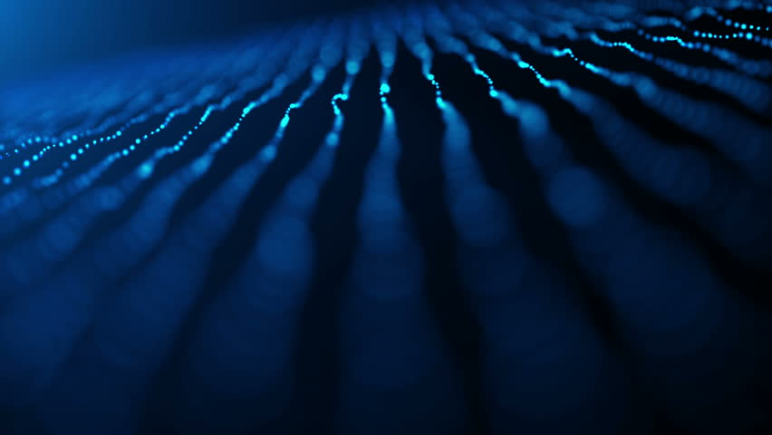 Rows of blue ribbons made up of particles gently float and sway against a dark blue background. With depth of field for added effect. | Shutterstock HD Video #22957795