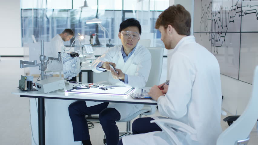 4K Electronics engineers working in lab building & testing electronic devices Dec 2016-UK | Shutterstock HD Video #22966345