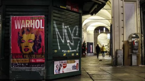Time-lapse of people walking in the city, near an Andy Warhol poster. January 2017, Turin, Italy
