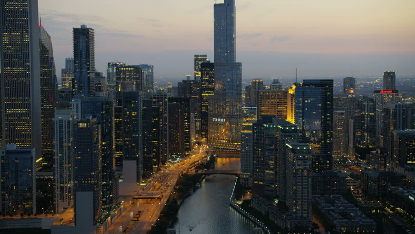 Chicago, USA - September 2016: Aerial sunset illuminated view of Trump Tower Chicago River Illinois Metropolitan skyline Skyscraper buildings in Downtown Business and Financial District USA RED DRAGON #22984915
