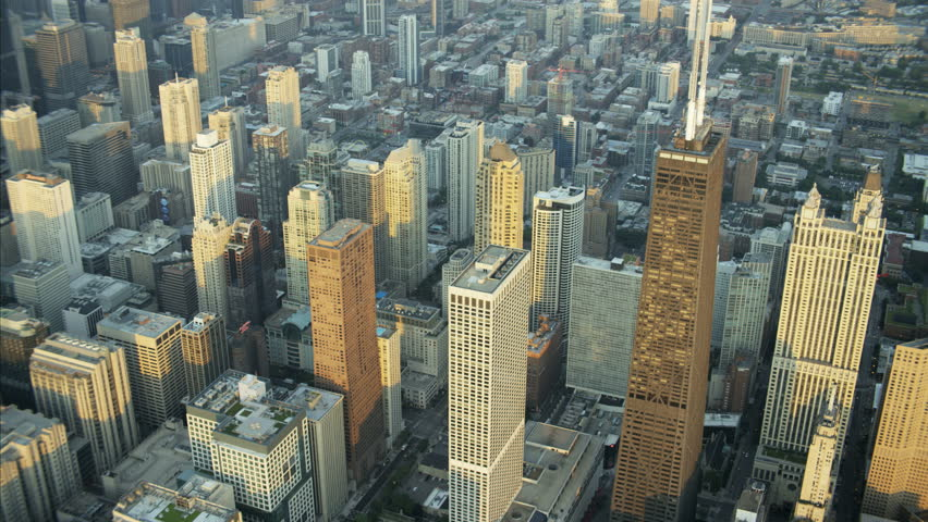Aerial view at sunrise of Chicago Skyscraper buildings Financial District and skyline USA RED DRAGON | Shutterstock HD Video #22988965