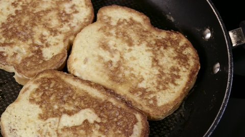 french toast cooking in frying pan close up