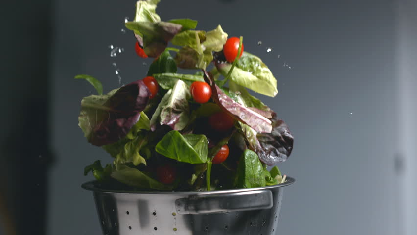 Salad flying out of colander in super slow motion, shot on Phantom Flex 4K | Shutterstock HD Video #23012845