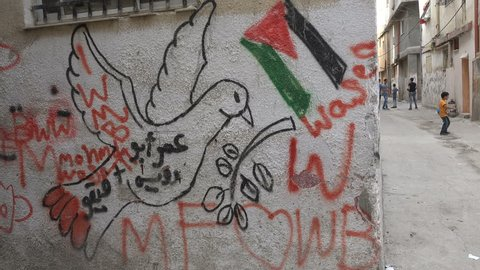 RAMALLAH, WEST BANK - OCTOBER 2016: Painting of a peace pigeon in the permanent Palestinian refugee camp (Al Amari) in Ramallah in the West Bank