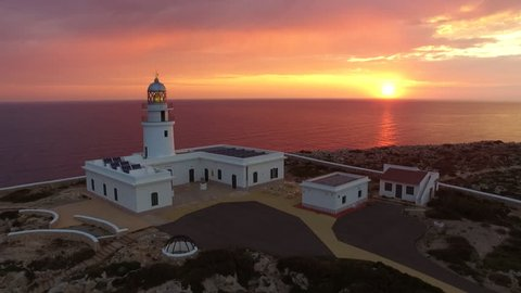 Stunning aerial shot of  lighthouse  in Menorca Island with beautiful sunrise.