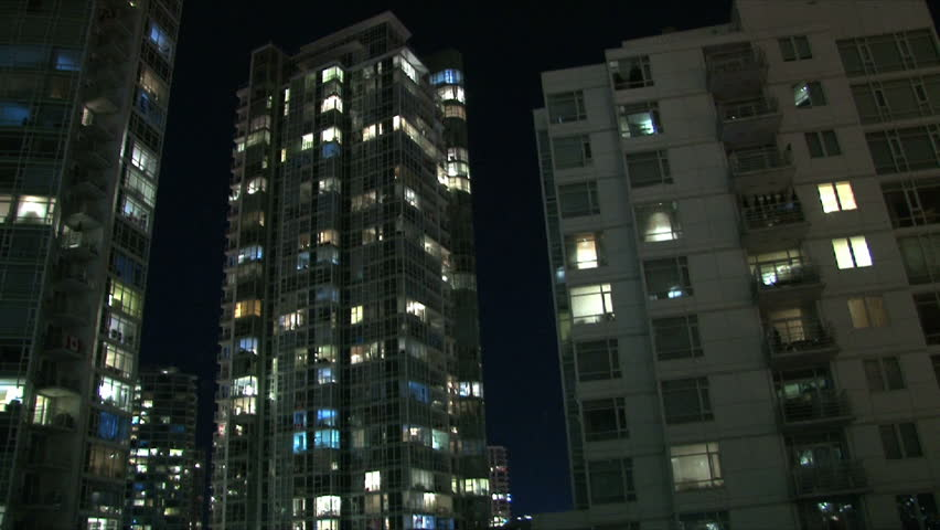 City life at night in Vancouver Canada showing many people in their  condominium homes turning on