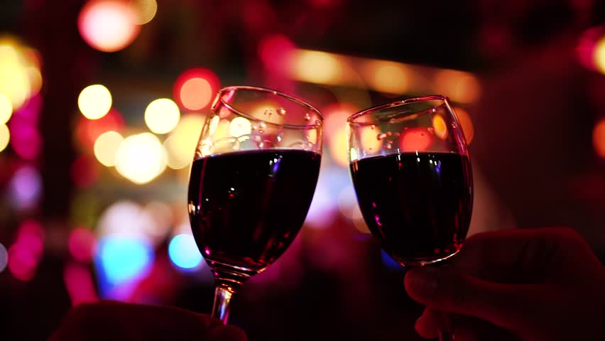Two People Cheers or Toast Red Wine Glasses Clinking. Holiday Celebration Concept.