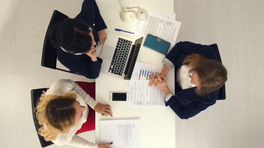 Business women shaking hands, finishing up a meeting   Shutterstock HD Video #23056171