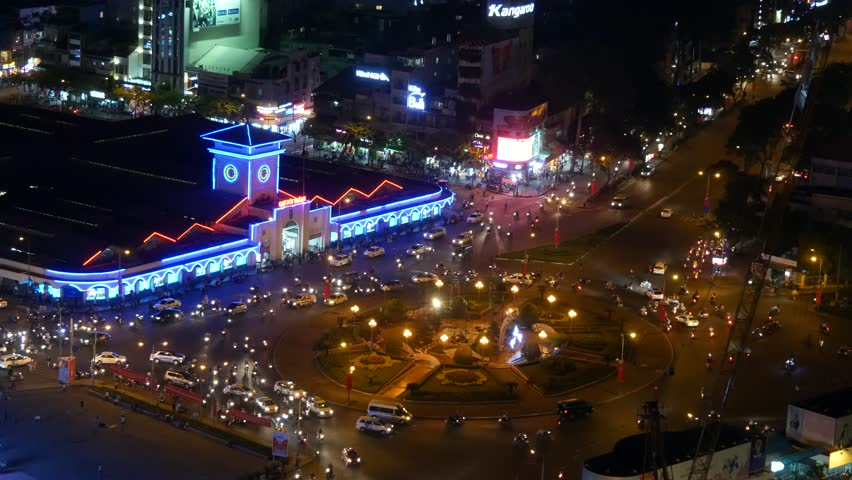 Impression, colorful, vibrant scene of traffic, dynamic, crowded city on street, Quach Thi Trang roundabout at Ben Thanh market, Ho Chi Minh city, Vietnam | Shutterstock HD Video #23065315