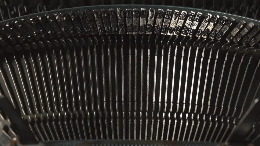 Detail of an old typewriter, machine of the 30s. The light from the darkness goes to the detail of typewriter | Shutterstock HD Video #23075275