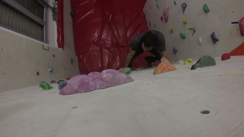 Young Man on Indoor Climbing Wall | Shutterstock HD Video #23075395