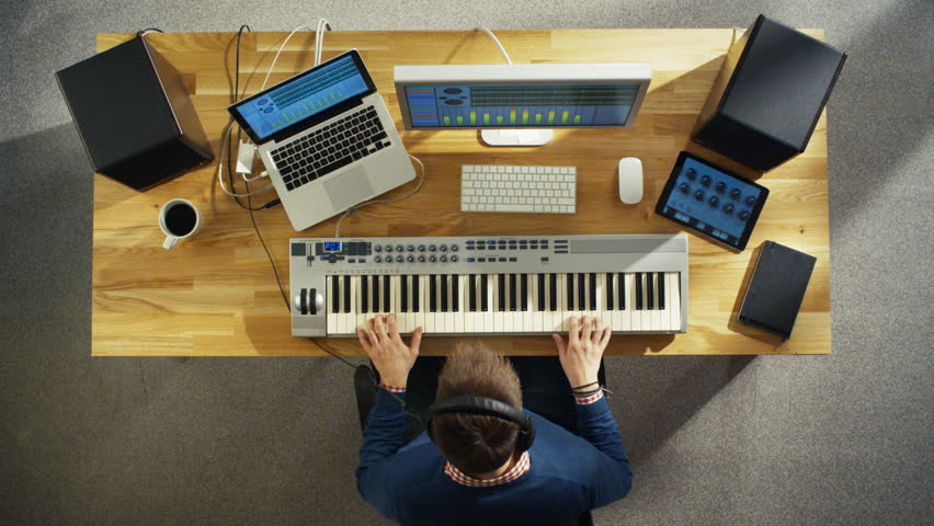 Top View of a Musician Creating Music at His Studio, Playing on a Musical Keyboard. His Studio is Sunny and Pleasant Looking. Shot on RED Cinema Camera in 4K (UHD).