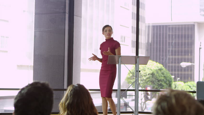 Young woman on stage presenting a business seminar, shot on R3D | Shutterstock HD Video #23121835