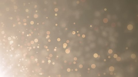Soft beautiful gold backgrounds.Moving golden gloss particles on background loop. Winter theme Christmas background with snowflakes.
