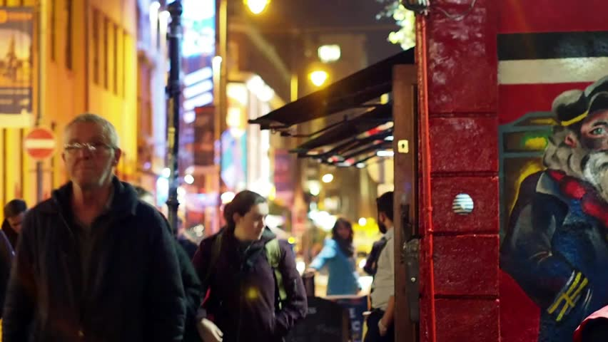 Dublin, Ireland, Temple Bar, November 2016 - People Walking by the Old Pub the Auld Dubliner With Mural, Barmen Smoking Outside, Pub Crawling, Night Life