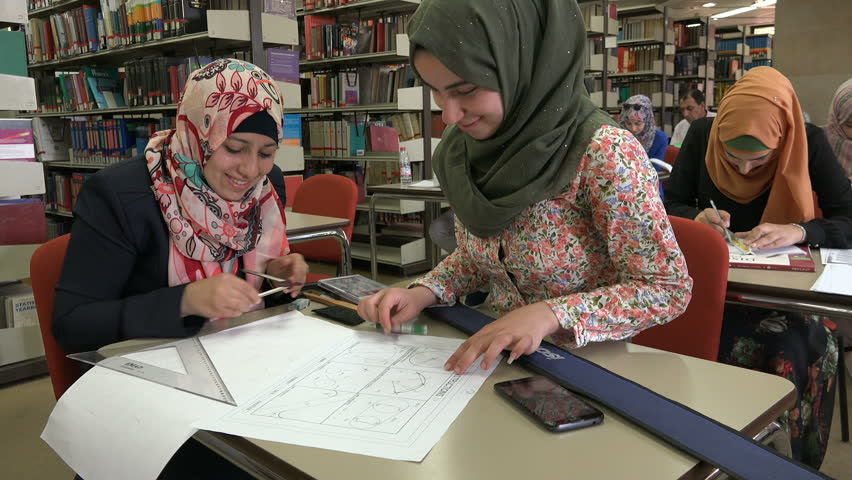 RAMALLAH, WEST BANK - OCTOBER 2016: Veiled Palestinian women study math and geometry in the library of the Bir Zeit University in Ramallah, higher education in the West Bank