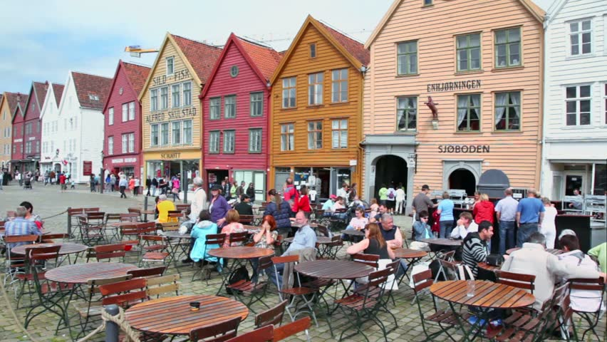 BERGEN - JUNE 27: People walk by street and sit in cafe, panorama at sunny summer day on JUNE 27, 2011 in Bergen, Norway.