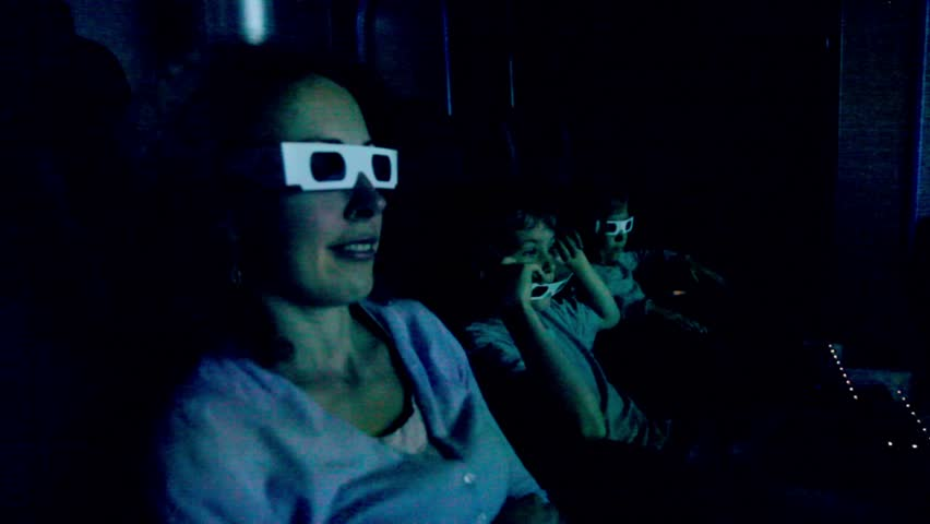 Family in 3d stereo glasses sit at cinema and watch movie with chair shake effects for motion imitation