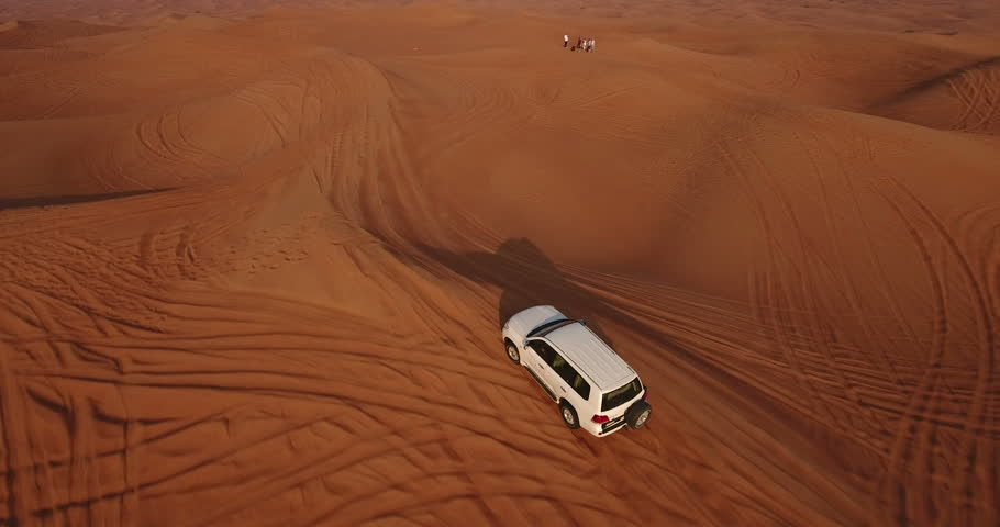 Aerial view of 4x4 off road land vehicle taking tourists on desert dune bashing safari in Dubai, UAE #23180065