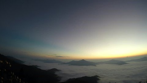 Sunrise of Phu Chee Pha Mountain Thailand. Part of the Doi Pha Mon, that rises near the border with Laos sloping towards the Mekong River. The highest point of the ridge is 1628 m high Doi Pha Mon.