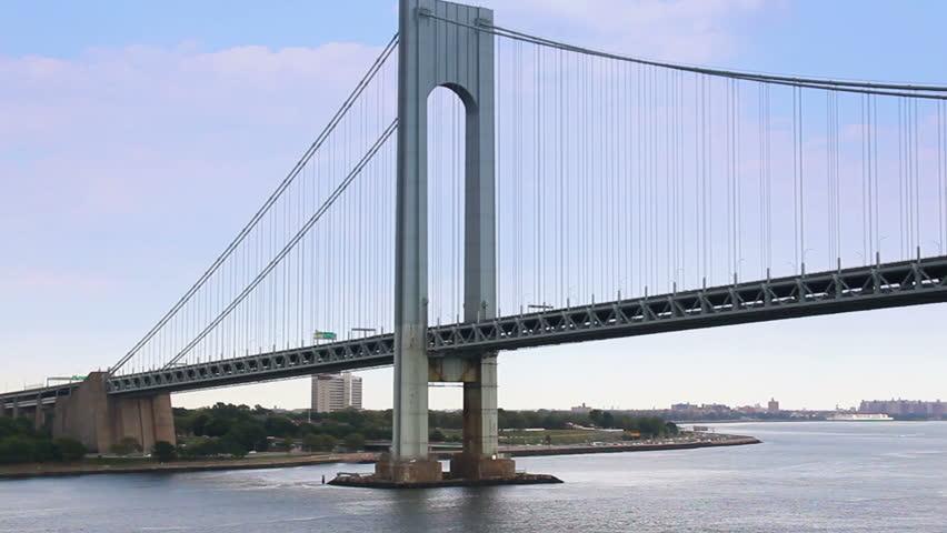 Time lapse shot traveling under the Verrazano-Narrows Bridge in New York Harbor near New York City.