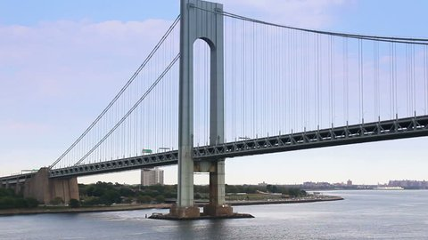 Time lapse shot traveling under the Verrazano-Narrows Bridge in New York Harbor near New York City.
