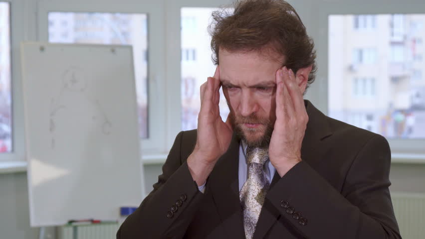 Attractive Caucasian Businessman Having Headache At The Office Close Up Of Handsome Middle Aged Man