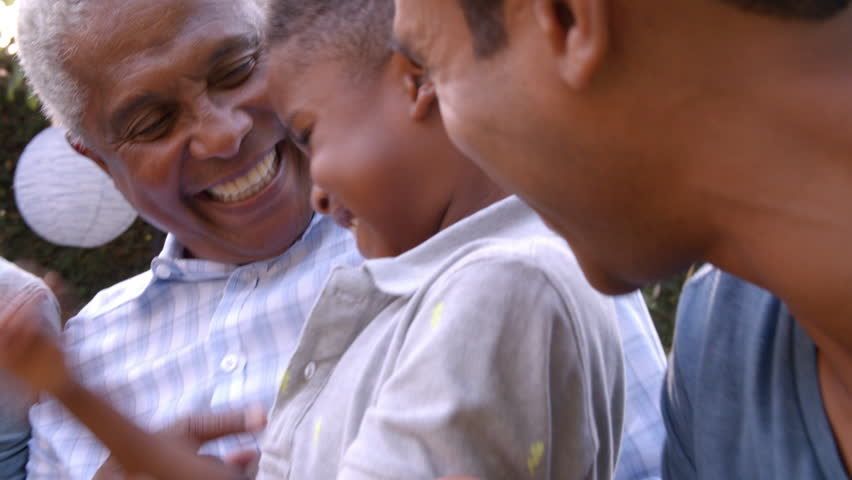 Young black boy playing with dad, uncle and grandad outdoors | Shutterstock HD Video #23190118