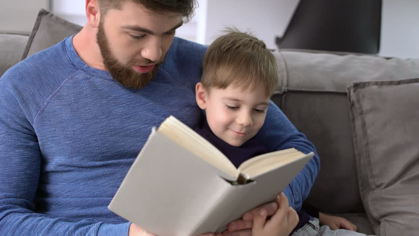 Image result for boy and father reading, looking serious