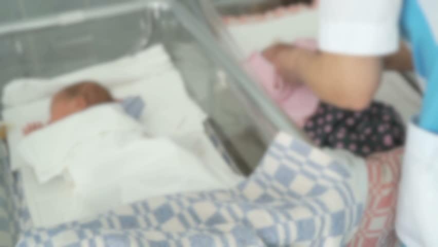 Nurse swaddles a newborn infant in a medical chamber | Shutterstock HD Video #23216452