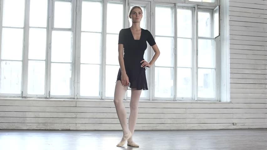 Ballet dancer raises a leg up in ballet class   Shutterstock HD Video #23228125
