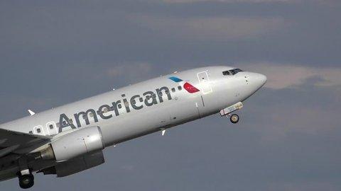 American Airlines plane taking off from airport runway - Logan Airport Boston, Massachusetts USA - June 5, 2015
