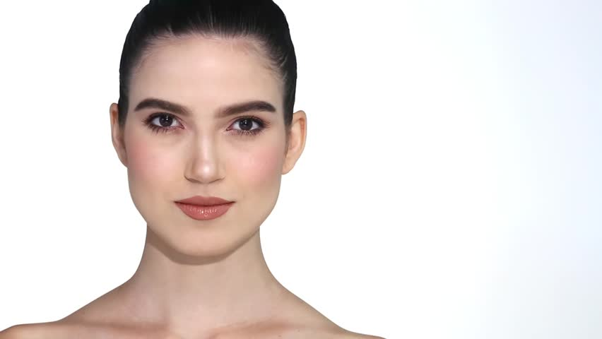 Beautiful Caucasian woman want to check eye, nose, eyebrow, forehead, cheek, jawline before plastic surgery, studio lighting white background copy space, ponytail hair fashion make up smile teeth