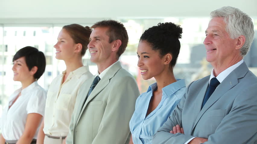 Business people in line looking away in a bright office | Shutterstock HD Video #2341136