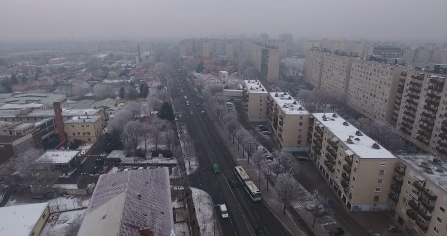 Aerial video shows the smog covered city of Debrecen in Hungary - 4K stock video clip