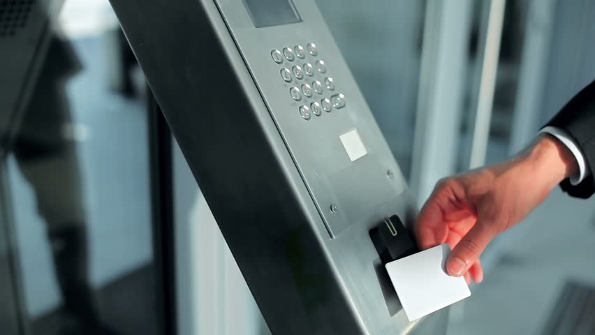 Close-up - the man put the card on checkpoint and open a door in building | Shutterstock HD Video #23430685