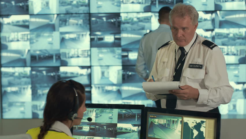 4K Security staff watching screens & discussing in observation control room | Shutterstock HD Video #23461246