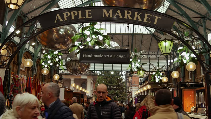 LONDON, UK - DECEMBER 20, 2016: Shoppers enjoy the Christmas decorations in Covent Garden market, 4k Ultrahd