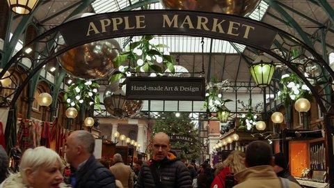 LONDON, UK - DECEMBER 20, 2016: Shoppers enjoy the Christmas decorations in Covent Garden market, 4k Ultrahd
