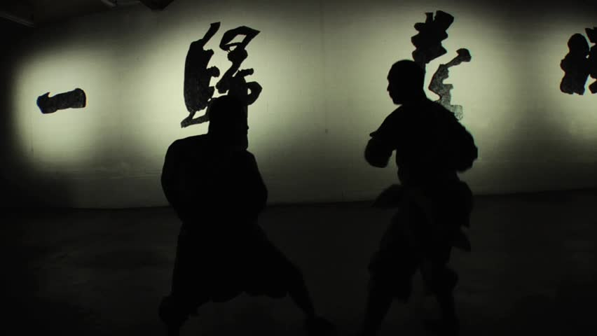 Two Shaolin monks practice their ancient form of hand-to-hand kung fu.